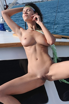 Busty girl naked on a boat